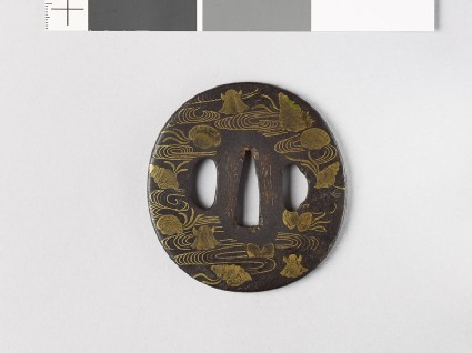 Tsuba with seashells amid water