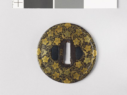 Round tsuba with karakusa, or scrolling floral pattern