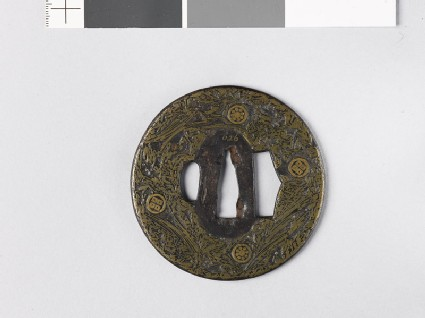 Round tsuba incrusted with brass wire