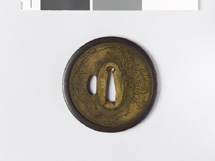 Tsuba with coiled dragons and stars
