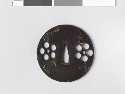 Round tsuba with heraldic mon and scrolls