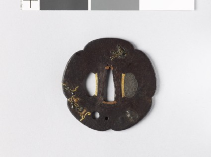 Lobed tsuba with butterflies, a toad, and a gourd-vine