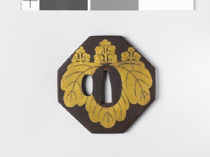Octagonal tsuba with gosan-no-kiri, or paulownia leaves