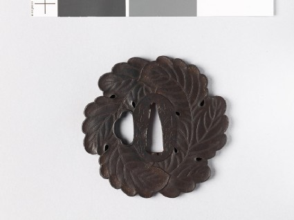 Tsuba in the form of two overlapping oak leaves