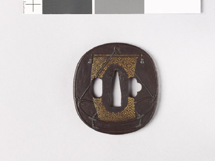 Tsuba depicting a property boat used in nō drama