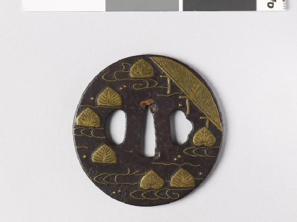 Tsuba with aoi, or wild ginger, floating on water
