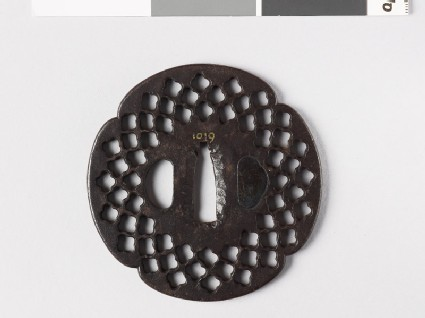 Mokkō-shaped tsuba with quatrefoil perforations