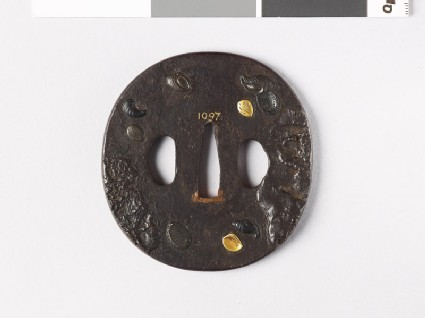 Tsuba with marine molluscs amid mud banks or rocks
