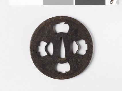 Tsuba with key pattern and seaweed-like sprays