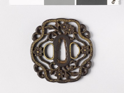 Tsuba with cruciform border and flowers