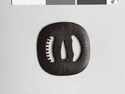 Lenticular tsuba with Amida-yasurime, or radial striations