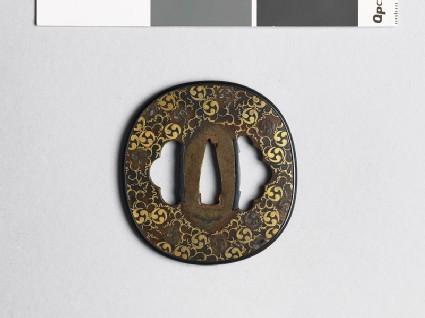 Tsuba with mitsudomoye, or three-comma shapes