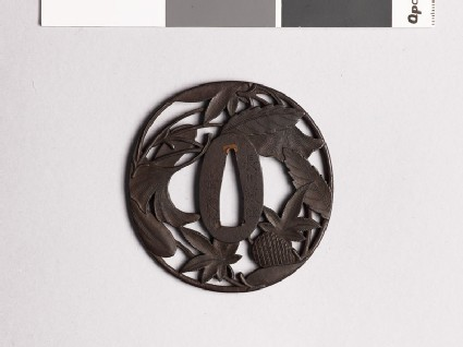 Tsuba with pine cone, needles, and leaves