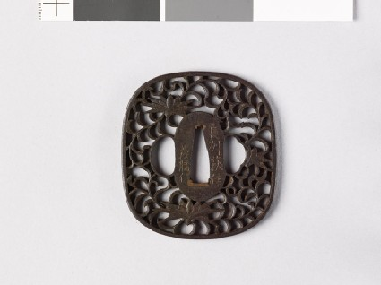 Tsuba with karakusa, or scrolling plant pattern