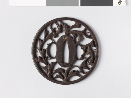 Round tsuba with karakusa, or scrolling plant pattern