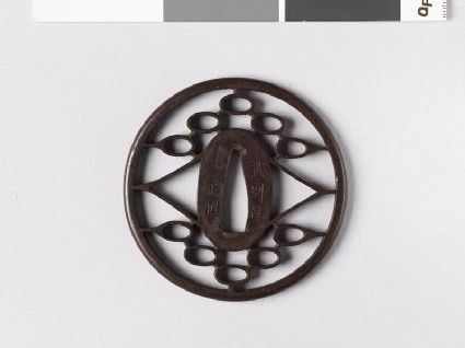 Round tsuba with triangles and ovals