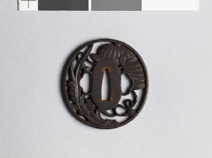 Tsuba with helmet and leaves