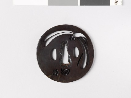 Round tsuba with mon formed from clematis flower and chariot wheel