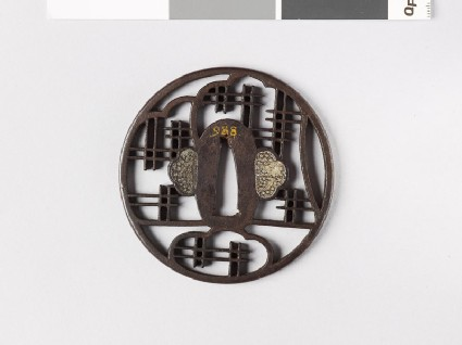 Round tsuba with lattice work