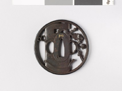 Round tsuba depicting a vase containing flowering plum twig