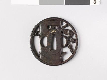 Round tsuba depicting a vase containing flowering plum twig