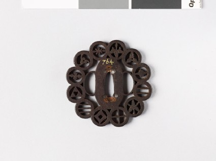 Lobed tsuba with 12 different mon
