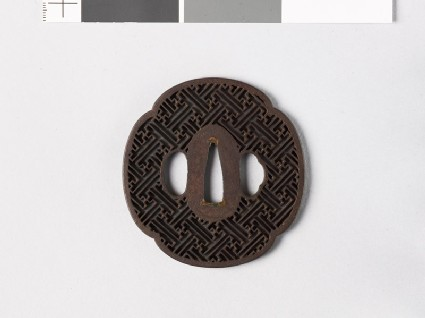 Mokkō-shaped tsuba with rinzu, or swastika-fret diaper