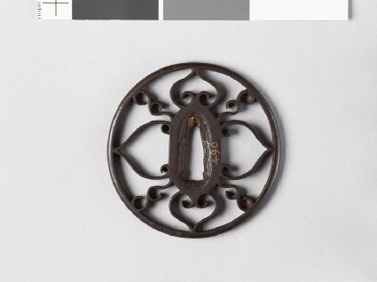 Round tsuba with scrolls and aoi, or wild ginger
