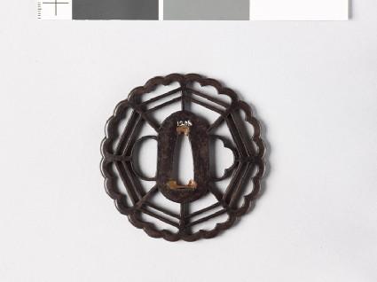 Tsuba with chrysanthemoid border enclosing a cobweb shape