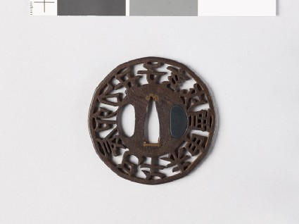 Round tsuba with characters representing the 12 animals of the Chinese zodiac