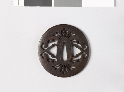 Lenticular tsuba with stylized flowers