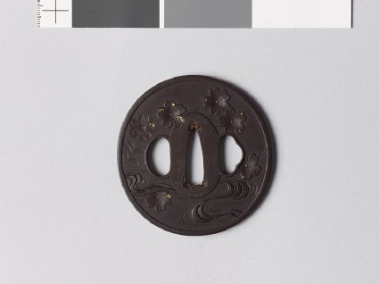 Tsuba with cherry blossoms falling towards a stream