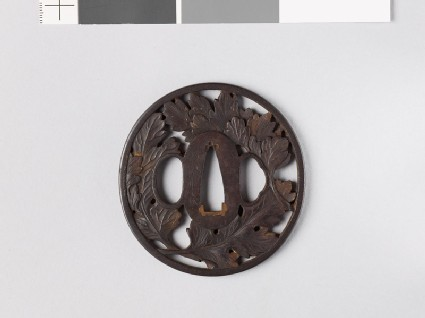 Tsuba with three chrysanthemum leaves