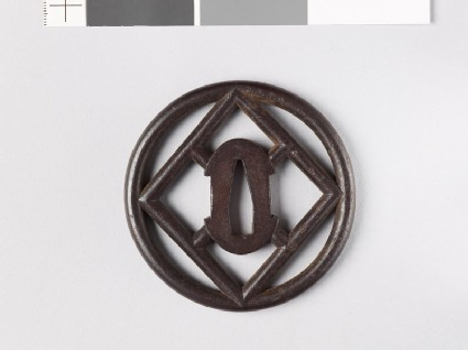 Tsuba with round border containing a lozenge