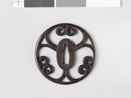 Round tsuba with scrolling cusps
