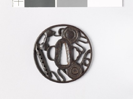 Round tsuba with six-holed flute and parts of a hand drum