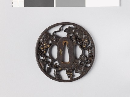 Round tsuba in the form of a grape vine