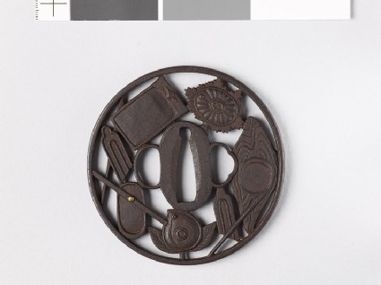 Round tsuba with writing impliments