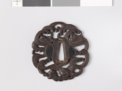 Tsuba with mandarin ducks and waves
