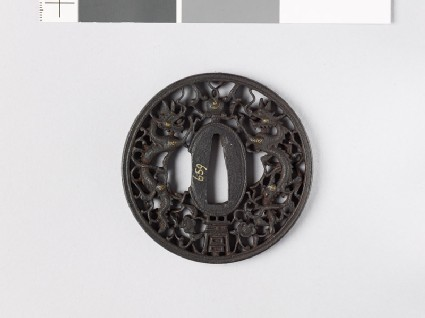 Tsuba with dragons and pearls amid karakusa, or scrolling plant pattern