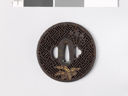 Round tsuba with rinzu, or swastika-fret diaper, and mon made from kiri, or paulownia leaves