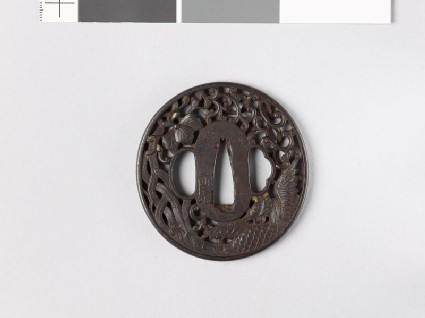 Tsuba with phoenix, flowers, and mon made from kiri, or paulownia leaves