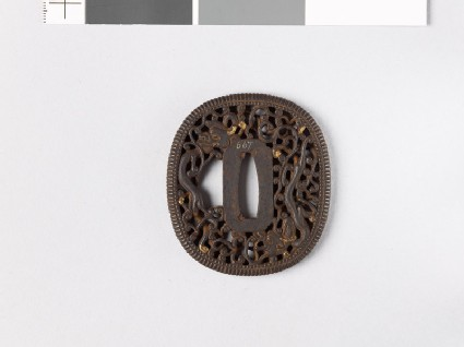 Tsuba with dragon amid scrollwork