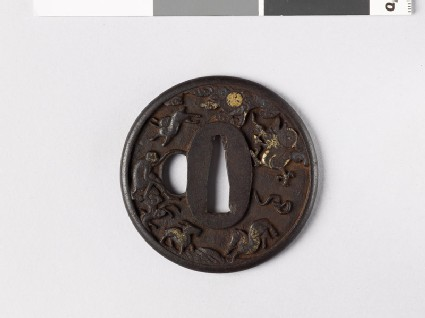 Round tsuba with animals of the Chinese zodiac amid rocks