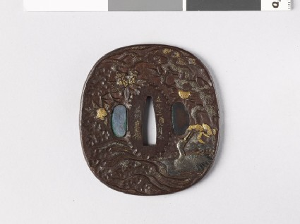 Tsuba depicting a swimming crane