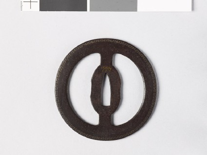 Round tsuba with fret patterns
