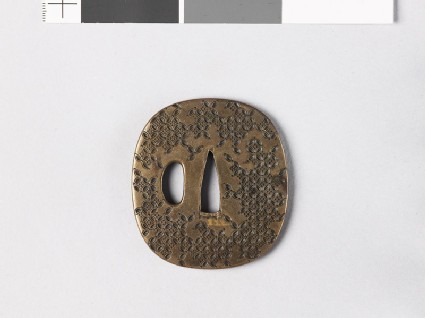 Tsuba with hanawachigai, or interlaced circles enclosing karahana
