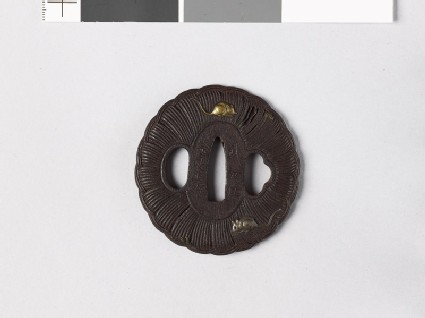 Lobed tsuba in the form of a rice bale with two rats