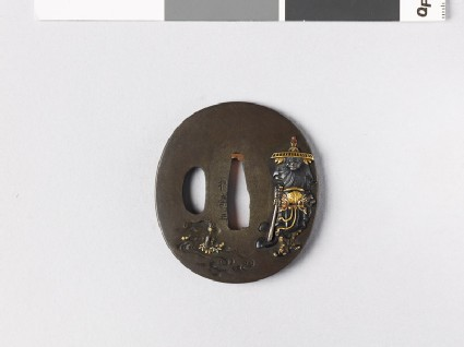 Tsuba depicting Shōki and a demon