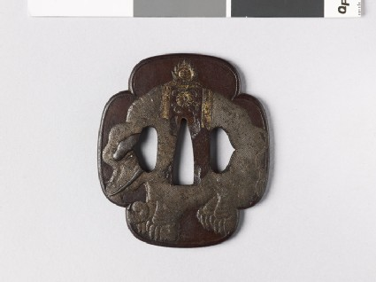 Mokkō-shaped tsuba with an elephant, chrysanthemum, and tama, or sacred jewels
